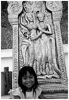 Girl and sculpture at Wat Phnom. Phnom Penh, Cambodia (black and white)