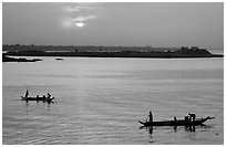 Boats at sunrise, Tonle Sap river,  Phnom Phen. Cambodia (black and white)