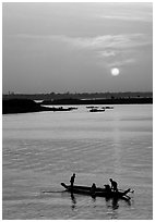 Boat and sunrise, Tonle Sap,  Phnom Phen. Cambodia (black and white)