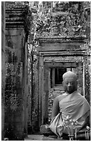 Buddha image, swathed in reverence, with offerings, the Bayon. Angkor, Cambodia (black and white)