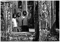 Girls in temple complex, the Bayon. Angkor, Cambodia (black and white)