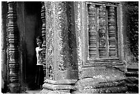 Girl hides in Ta Prom. Angkor, Cambodia (black and white)