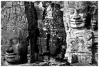 Large stone faces occupying towers, the Bayon. Angkor, Cambodia ( black and white)
