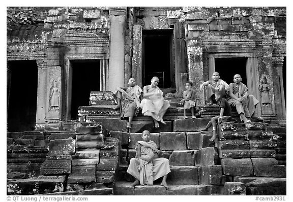 Buddhist monks sitting on steps, Angkor Wat. Angkor, Cambodia (black and white)