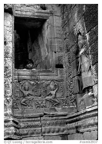 Boy hides in the Bayon. Angkor, Cambodia (black and white)