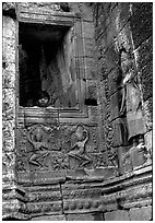 Boy hides in the Bayon. Angkor, Cambodia ( black and white)