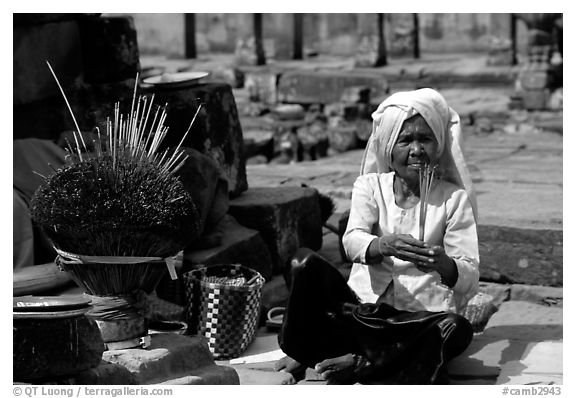 Incence vendor wearing traditional headcloth. Angkor, Cambodia (black and white)