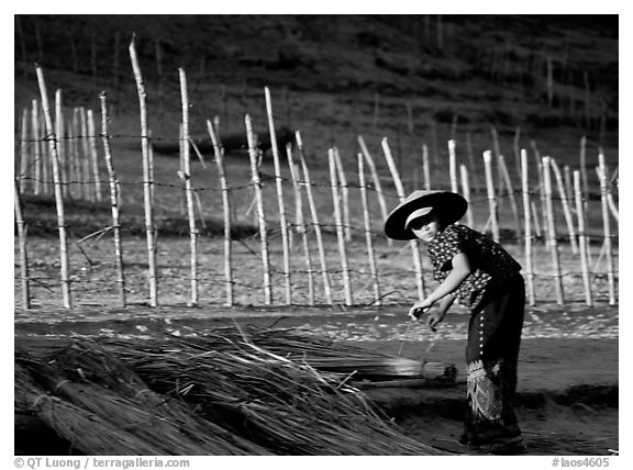 Villager and fence. Mekong river, Laos (black and white)