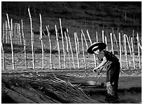 Villager and fence. Mekong river, Laos ( black and white)