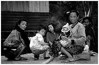 Group of women and children in a small hamlet. Mekong river, Laos ( black and white)
