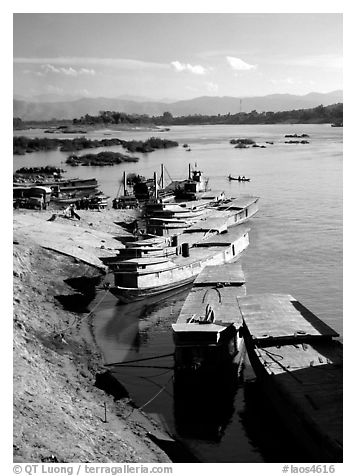 Slow passenger boats in Huay Xai. Mekong river, Laos (black and white)