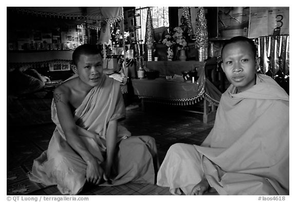 Buddhist novice monks inside temple. Luang Prabang, Laos (black and white)