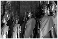 Drapped Buddha statues, Wat Xieng Thong. Luang Prabang, Laos (black and white)