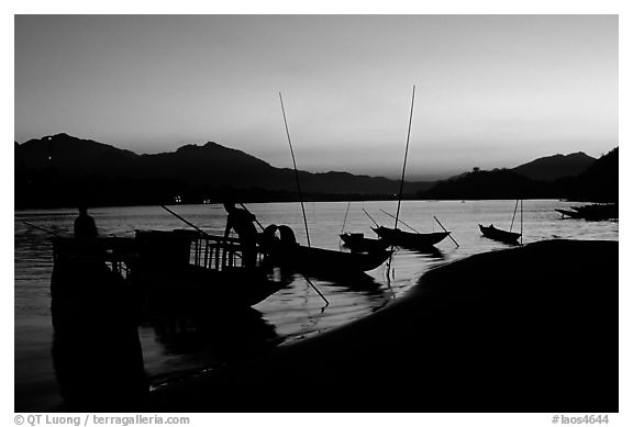 Boats, sunset on the Mekong river. Luang Prabang, Laos (black and white)