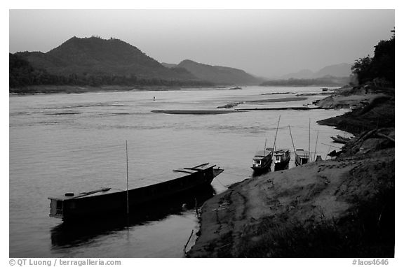Dusk on the Mekong river framed by coconut trees. Luang Prabang, Laos (black and white)