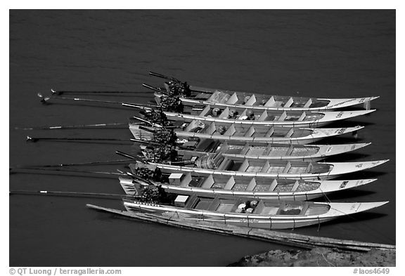 Fast boats on the Mekong river. With their 40 HPW Toyota engines, they cruise at 50 mph on the river. Mekong river, Laos (black and white)