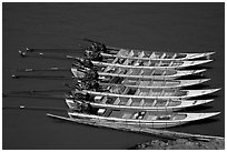 Fast boats on the Mekong river. With their 40 HPW Toyota engines, they cruise at 50 mph on the river. Mekong river, Laos ( black and white)