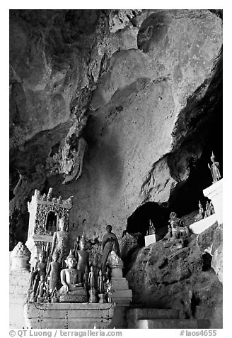 Novice Buddhist monk in  Tham Ting cave,  Pak Ou. Laos (black and white)