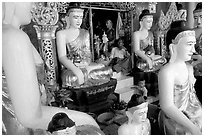 Surrounded by Buddha statues, Shwedagon Paya. Yangon, Myanmar (black and white)