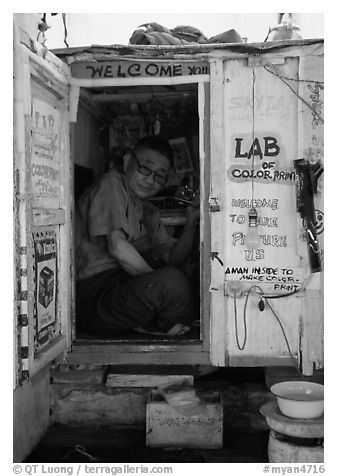 Man in one-room photo lab. Bagan, Myanmar (black and white)