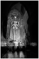 One of four monumental statues inside Ananda pahto. Bagan, Myanmar (black and white)