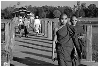 On the two century old U Bein bridge, Amarapura. Mandalay, Myanmar (black and white)