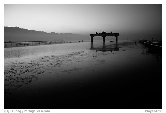 The gate of the lake, sunrise. Inle Lake, Myanmar (black and white)