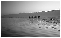 Long boat,  stilts huts, and mountains, sunrise. Inle Lake, Myanmar (black and white)