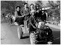 Riding tractor on road near Swwenyaung. Shan state, Myanmar (black and white)