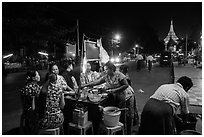 Streat food served at night, Shwedagon Pagoda in background. Yangon, Myanmar ( black and white)