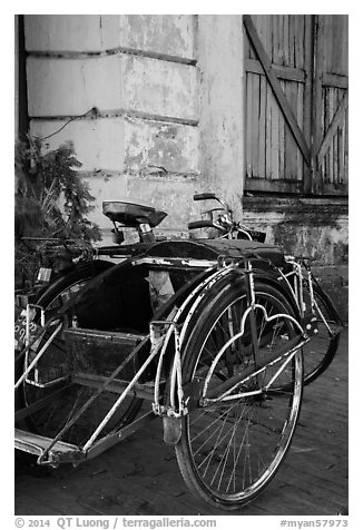 Sai kaa rickshaw and old facade. Yangon, Myanmar (black and white)