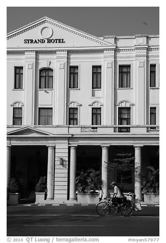 Rickshaw and Strand Hotel. Yangon, Myanmar (black and white)