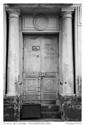 Door framed with columns. Yangon, Myanmar (black and white)