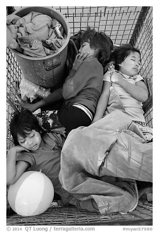 Children sleeping in street cleaning cart. Yangon, Myanmar (black and white)