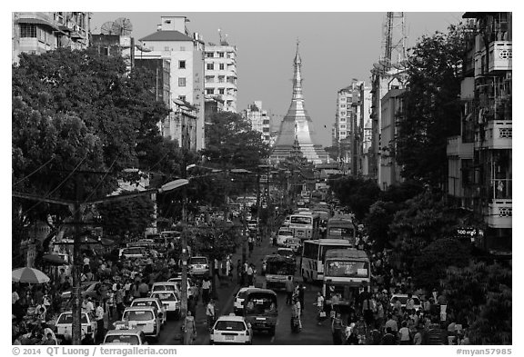 Street with busy traffic leading to Sule Pagoda. Yangon, Myanmar (black and white)