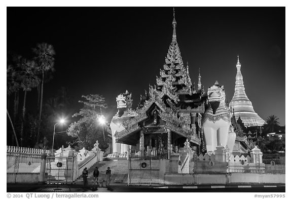 Southern gate guarded by two leogryphs and Main Stupa at night, Shwedagon Pagoda. Yangon, Myanmar (black and white)