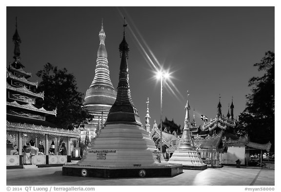 Shrines, stupas, and Main Stupa at dawn, Shwedagon Pagoda. Yangon, Myanmar (black and white)