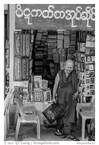 Monk leaves bookstore, Shwedagon Pagoda. Yangon, Myanmar (black and white)