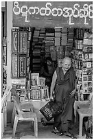 Monk leaves bookstore, Shwedagon Pagoda. Yangon, Myanmar ( black and white)
