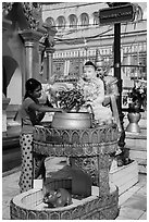 Woman worshipping at planetary post. Yangon, Myanmar ( black and white)