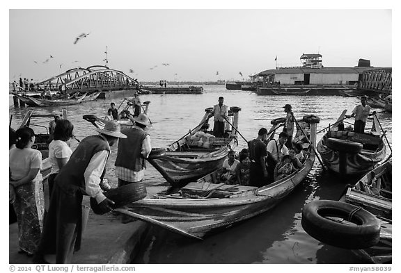 Passengers on oared water taxi crossing Yangon River. Yangon, Myanmar (black and white)