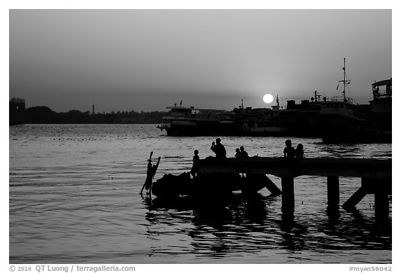 Diving into the Yangon River at sunset. Yangon, Myanmar (black and white)