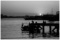 Diving into the Yangon River at sunset. Yangon, Myanmar ( black and white)