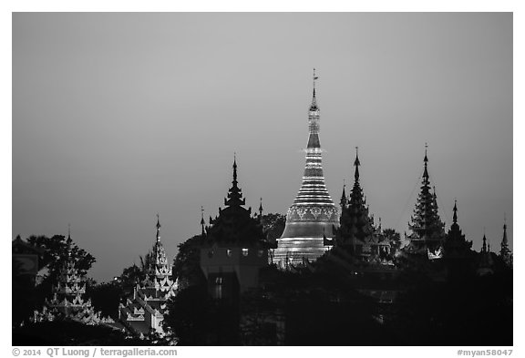 Distant view of Naungdawgyi Pagoda and shrines at dawn. Yangon, Myanmar (black and white)