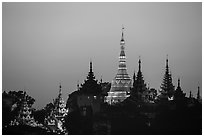 Distant view of Naungdawgyi Pagoda and shrines at dawn. Yangon, Myanmar ( black and white)