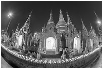 Oil lamps and stupas at dusk, Shwedagon Pagoda. Yangon, Myanmar ( black and white)