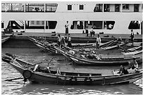 Long-tail boats and ferry, Sinodan pier. Yangon, Myanmar ( black and white)