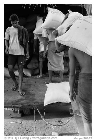 Workers load bags of rice into truck, Sinodan pier. Yangon, Myanmar (black and white)