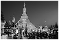 Praying from the Victory Ground, Shwedagon Pagoda, dusk. Yangon, Myanmar ( black and white)