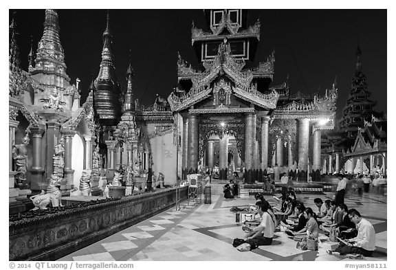 Praying on the platform at night. Yangon, Myanmar (black and white)